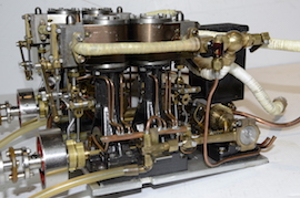 side view Stuart double 10 vertical live steam marine engine for sale